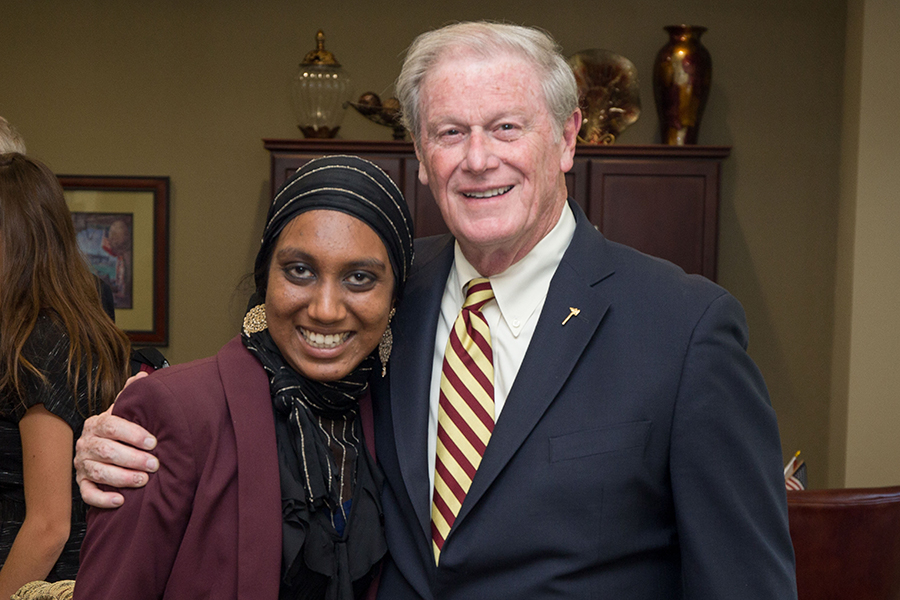 Power of WE founding director Inam Sakinah and President John Thrasher.