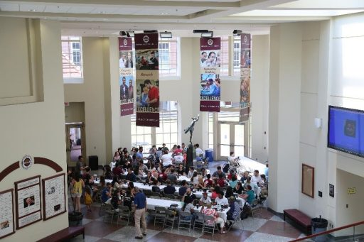 New FSU medical students gather for a welcome picnic in the atrium of the College of Medicine's John Thrasher Building.