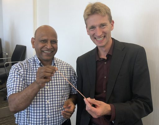 FAMU-FSU College of Engineering Professor and Associate Director of CAPS Sastry Pamidi and Danko van der Laan, president and CEO Advanced Conductor Technologies, show off Conductor on Round Core cable technology.