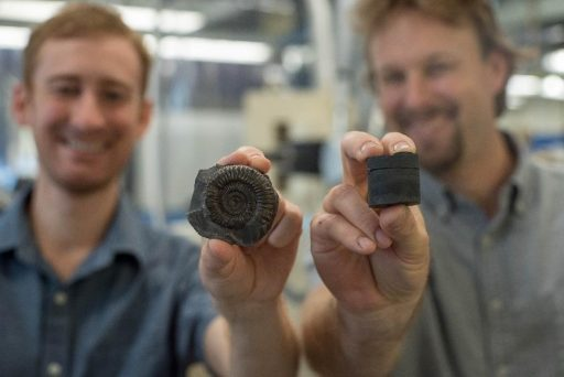 Postdoctoral Researcher Theodore Them (left, holding an extinct fossil sample) and Assistant Professor Jeremy Owens (right, holding a rock core sample). The researchers used the samples to study the global record of oxygenation. Credit: Stephen Bilenky