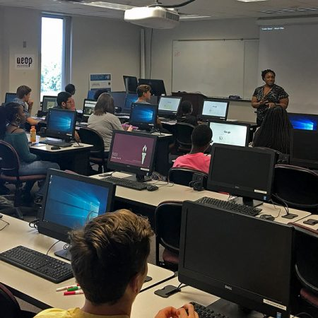 iSchool instructor Christy Chatmon helps high school students from Leon and Gadsden counties learn tech skills at FSU iCamp, hosted in partnership with the U.S. Army Educational Outreach Program. (Photo: College of Communication and Information)
