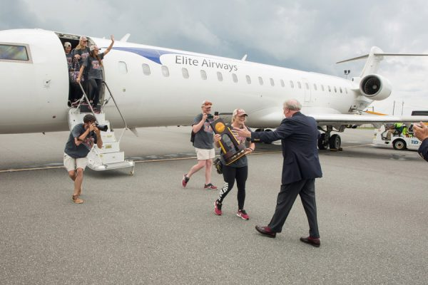 Florida State University President John Thrasher greets softball players at Tallahassee International Airport on June 6, 2018, following their victory at the 2018 Women's College World Series in Oklahoma City. (FSU Photography Services)