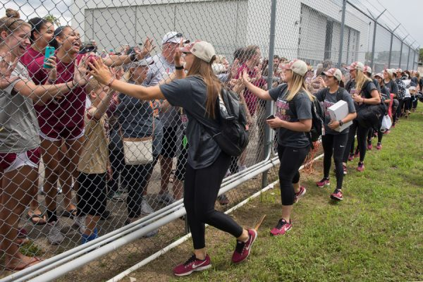 FSU softball players greet fans gathered at Tallahassee International Airport to welcome home the NCAA Softball National Champions. (FSU Photography Services)