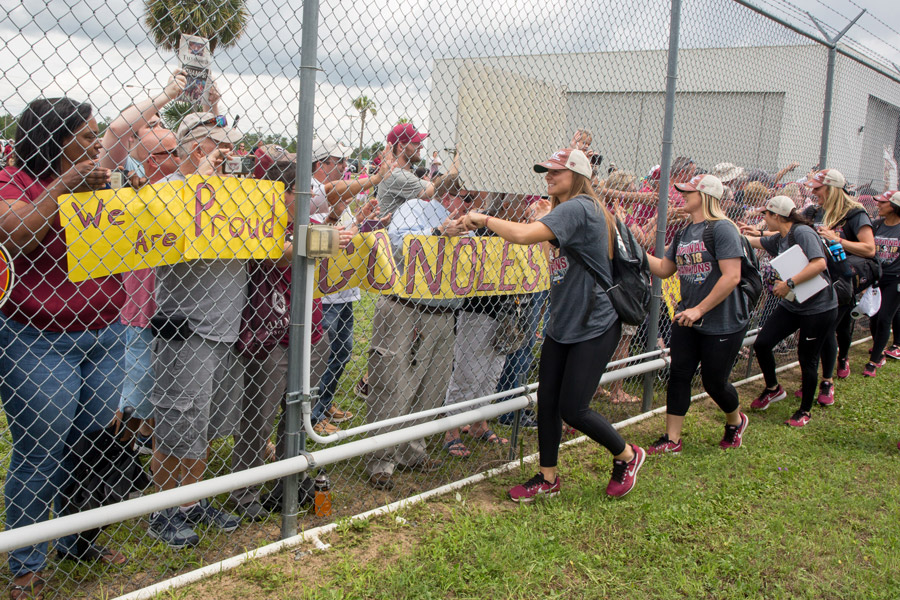 FSU softball players greet fans gathered at Tallahassee International Airport to welcome home the NCAA Softball National Champions on June 6, 2018. (FSU Photography Services)