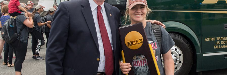 FSU President John Thrasher welcomes home star player Jessie Warren at Tallahassee International Airport on June 6, 2018, following the team's victory at the 2018 Women's College World Series in Oklahoma City. (FSU Photography Services)
