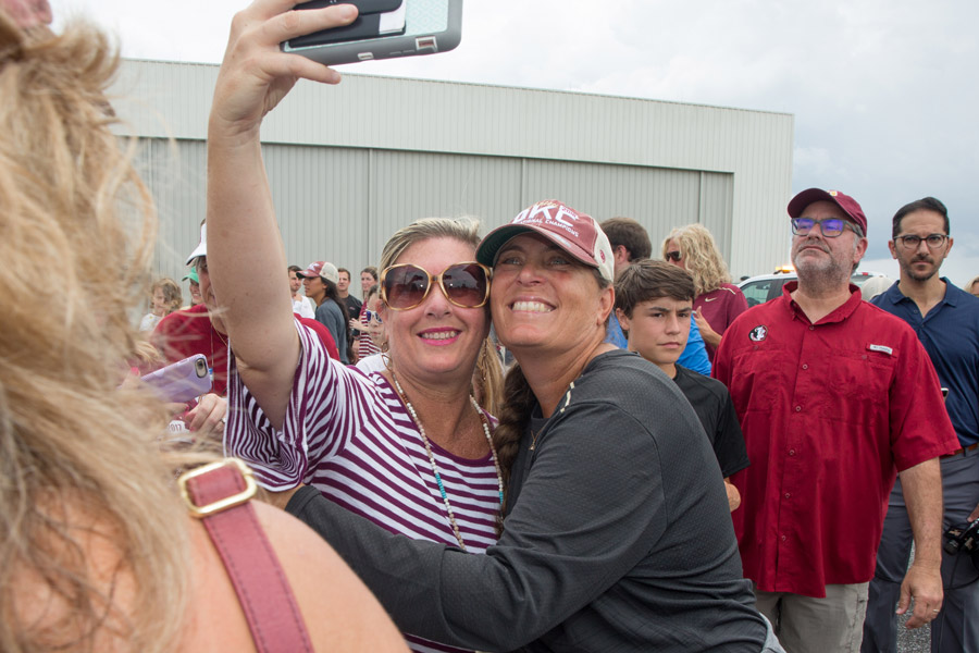 FSU Softball Coach Lonni Alameda takes a selfie with a fan at Tallahassee International Airport on June 6, 2018, after arriving home from the team's victory at the 2018 Women's College World Series in Oklahoma City. (FSU Photography Services)