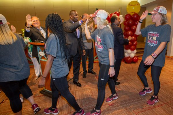 FSU National Champion softball players exchange high-fives with Tallahassee city commissioners on June 6, 2018. (FSU Photography Services)