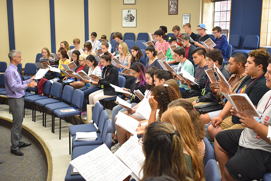 Choral campers rehearse with Kevin Fenton, professor of choral conducting and ensembles, at FSU Summer Music Camps.