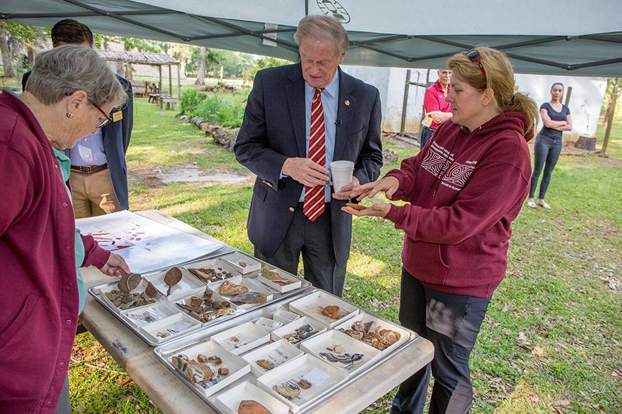 President John Thrasher visits the dig site at Mission San Luis.