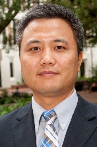 Gang Wang, Assistant Professor of Management