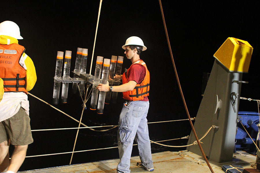 Stukel preparing sediment traps, which his team used to collect sinking particles for the study.