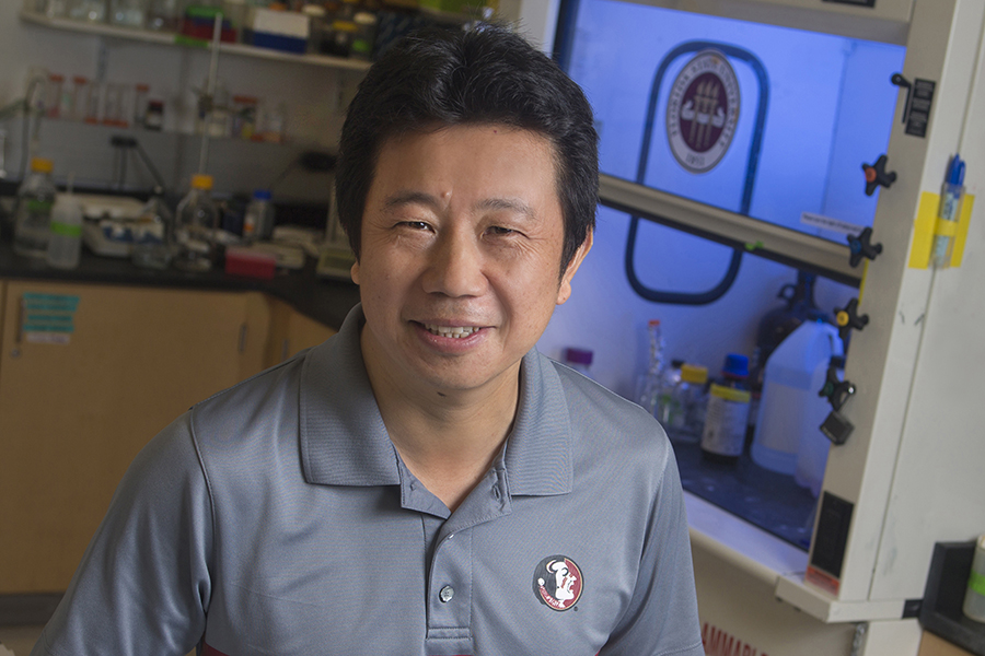 Hengli Tang, professor of biological science