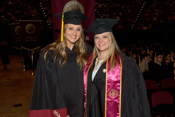 New graduates Rachel Hollingsworth and Margaret Howard are all smiles at FSU's summer commencement Aug. 3, 2018. (FSU Photography Services)