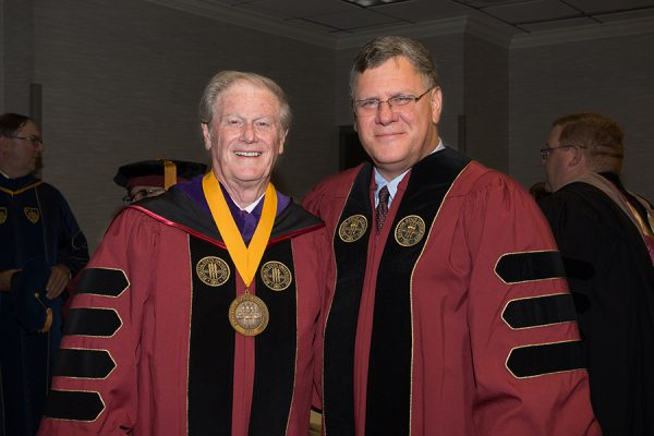 President John Thrasher and FSU Trustee Jorge Gonzalez prepare for summer commencement Friday, Aug. 3, 2018. (FSU Photography Services)