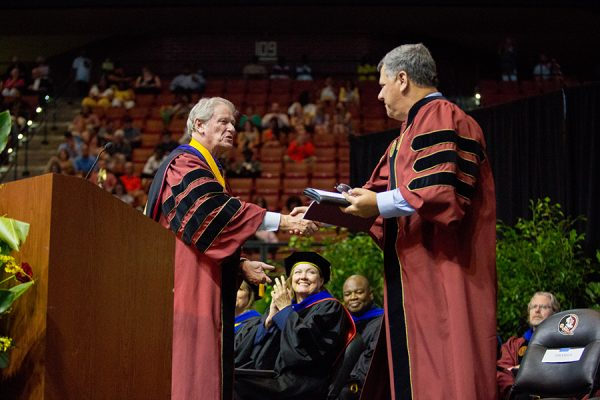 President John Thrasher welcomes FSU Trustee Jorge Gonzalez to address summer graduates at commencement Aug. 3, 2018. (FSU Photography Services)