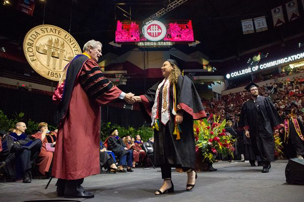 President John Thrasher congratulates graduates at summer commencement Aug. 3, 2018. (FSU Photography Services)