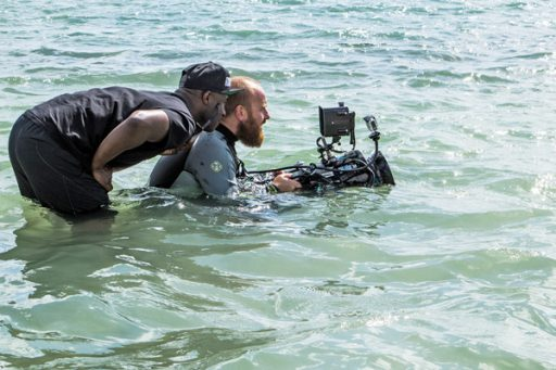 "Academy Award-winner Barry Jenkins sizes up a shot with his friend and cinematographer James Laxton during the filming of ""Moonlight"" in Miami in 2015. (Courtesy: A24 Films)"