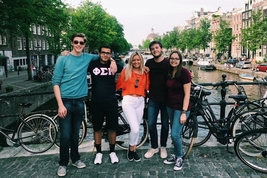 Binkley (center) with some friends on a weekend trip to Amsterdam, Netherlands.