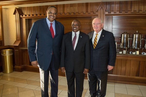 U.S. Rep. Al Lawson and Florida Sen. Bill Montford post with President Masisi at a reception Thursday, Sept. 20, 2018. (FSU Photography Services)