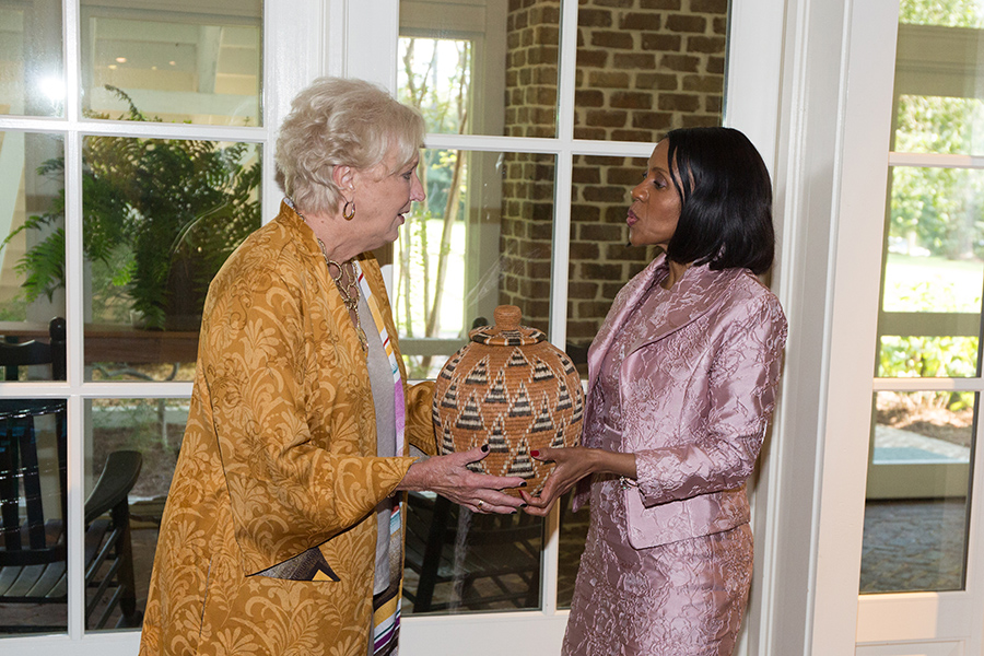 FSU First Lady Jean Thrasher and Botswana First Lady Mrs. Neo Jane Masisi exchange gifts during a luncheon at the President's House Thursday, Sept. 20, 2018. (FSU Photography Services)