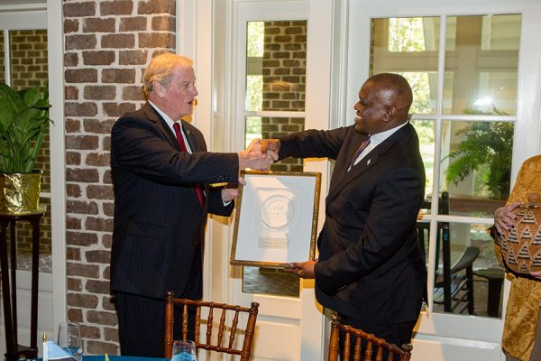 FSU President John Thrasher and Botswana President Masisi exchange gifts during a luncheon at the President's House Thursday, Sept. 20, 2018. (FSU Photography Services)