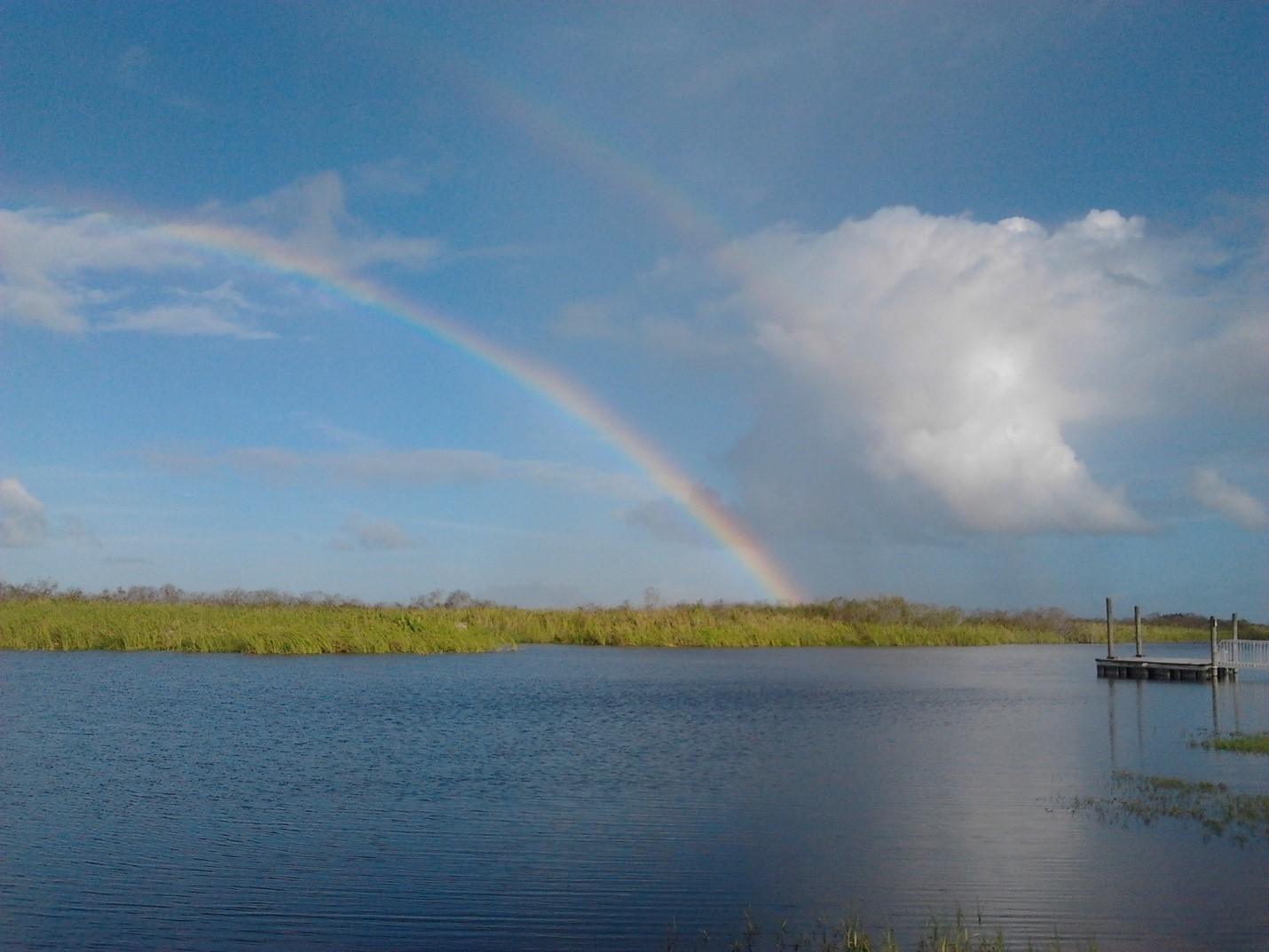 A rainbow appears over a northern Everglades study site, one of a number of sites from around the world sampled by Hodgkins and her team. Credit: Hodgkins