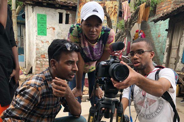 Dwight James III (right) films an anti-smoking advertisement in Dakshindari, India.