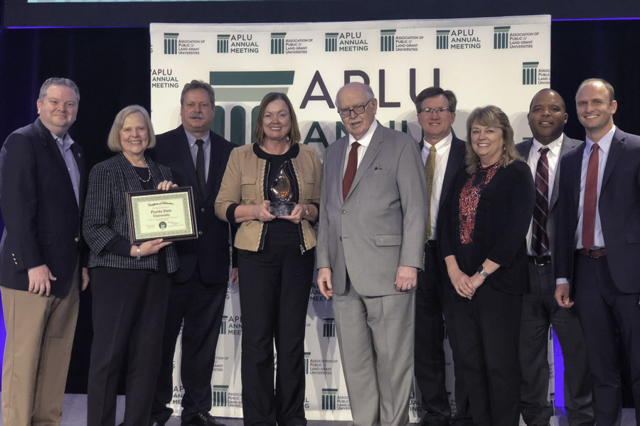 "Provost and Executive Vice President for Academic Affairs Sally McRorie, along with a team of FSU leaders, accepts the prestigious national award from APLU President Peter McPherson. He praised FSU's accomplishment. ""Global experience and collaboration is more important than ever,"" McPherson said. ""We're delighted to spotlight the exceptional example Florida State University has set in achieving comprehensive internationalization."" (Nov. 11, 2018)"