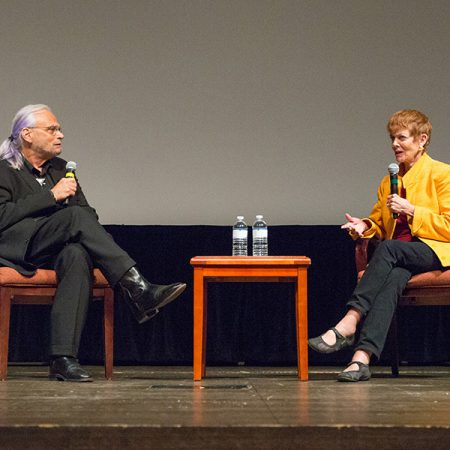 "Paul Cohen, executive director of the Torchlight Program, discusses ""Memphis Belle"" with Catherine Wyler, daughter of filmmaker William Wyler at the 8th annual Veterans Film Showcase. (FSU Photography Services)"