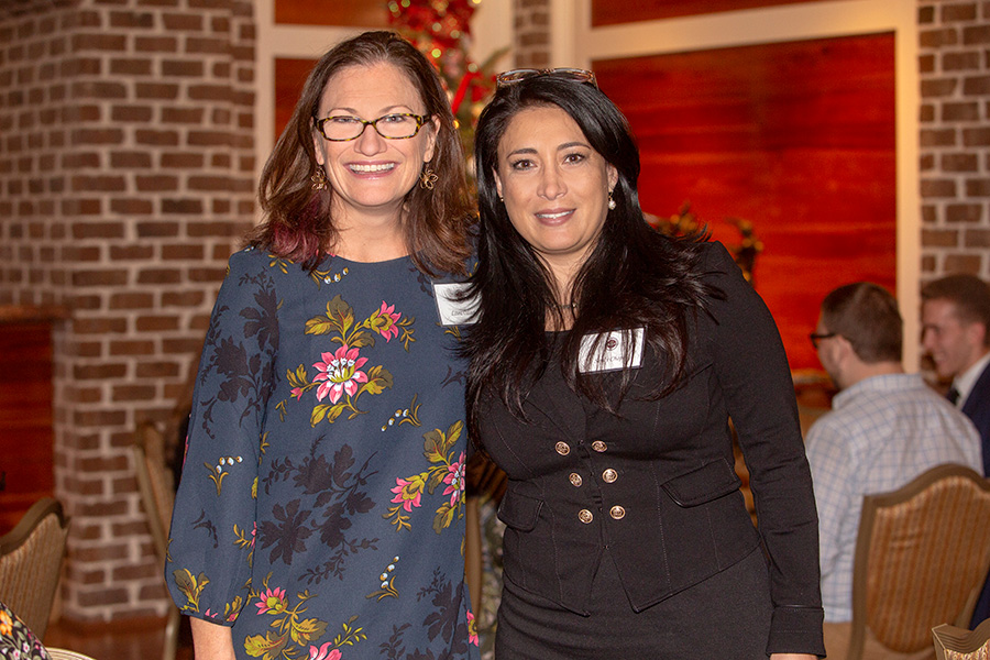 Laura Osteen, director of the Center for Leadership and Social Change, with Sindy Chapa, associate professor of communication, at the Transformation Through Teaching awards dinner Nov. 29, 2018. (FSU Photography Services)