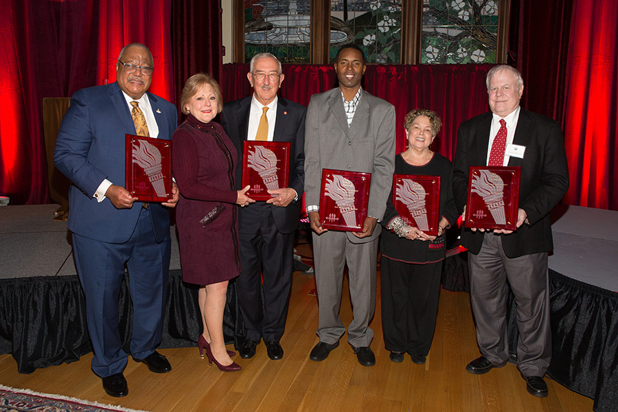 2018 Torch Award winners (from left): Melvin Stith; Nan and Mark Hillis; Charlie Ward; Val Richard Auzenne, accepting for Barry Jenkins; and Don Gibson. (FSU Photography Services)