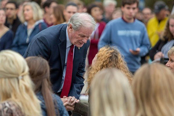 President John Thrasher talks with family of victims at Sunday's candlelight vigil. (FSU Photography Services)