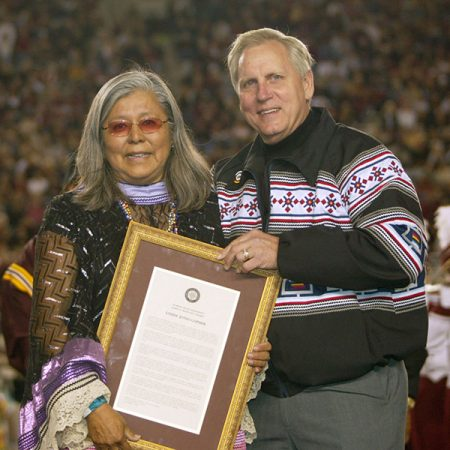Louise Jones Gopher, the first female member of the Seminole Tribe of Florida to earn a college degree, and Wetherell at Doak Campbell Stadium in 2007. Gopher was honored with the distinguished Westcott Award, named after James D. Westcott, Jr., one of FSU's original benefactors, is a rare honor reserved for those whose loyalty, advocacy and support of the university is deemed extraordinary.