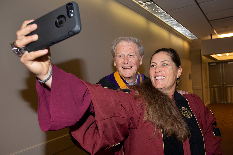 President John Thrasher and head softball coach Lonni Alameda at Florida State University fall commencement Dec. 15, 2018. (FSU Photography Services)