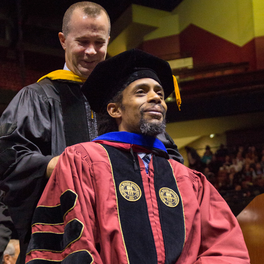Pablo Correa receives a doctoral hood from Professor Davis Houck, signifying he has completed all requirements for a doctorate in communication — 2018 Fall Commencement. (FSU Photography Services)