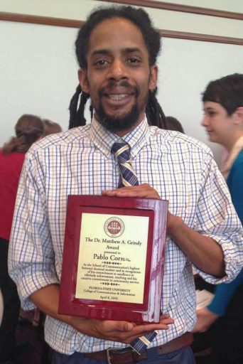 Pablo Correa accepted the Dr. Matthew A. Grindy Award in 2016, the highest doctoral award presented by the College of Communication and Information.