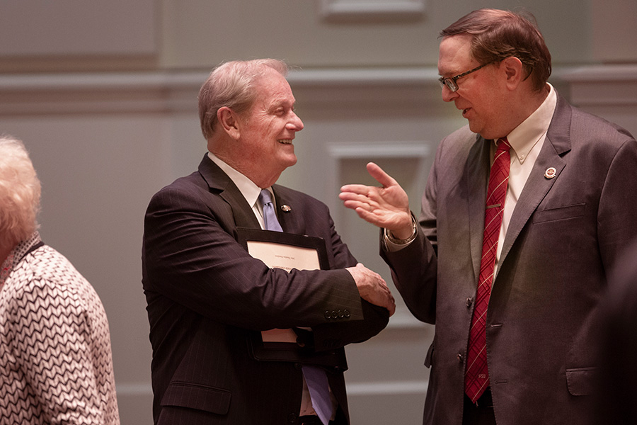 President John Thrasher speaks with FSU Faculty Senate President Todd Adams before the State of the University address Wednesday, Dec. 5, 2018. (FSU Photography Services)