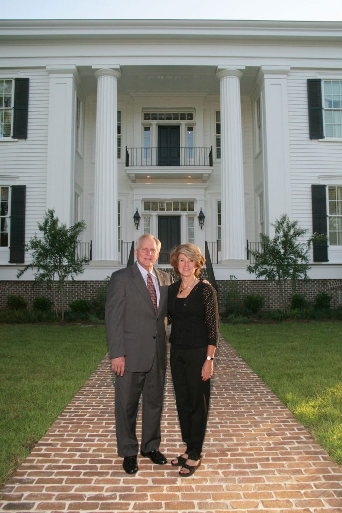 The 13th president of Florida State University, T.K. Wetherell, and his wife, Ginger, pose in front of the President's House on campus.
