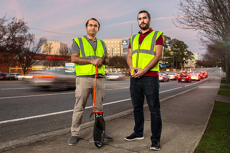 Assistant Professor of Civil Engineering Eren Ozguven and graduate student Mehmet Baran Ulak analyzed the location of automobile crashes to see when older drivers were most at risk. (Photo: Mark Wallheiser)