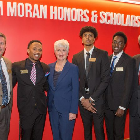 Randy Blass, Jan Moran and President John Thrasher recognized Jim Moran Scholars Hakeem Hunter, Robel Mechal and Jerry Jean-Pierre at a special reception at the Jim Moran Building in downtown Tallahassee, Jan. 16, 2019. (FSU Photography Services)