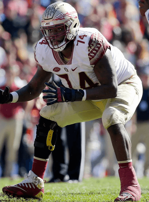 Though the brace has to be concealed with tape during games, players like former FSU offensive lineman Derrick Kelly (above) still benefit from its reinforced support.
