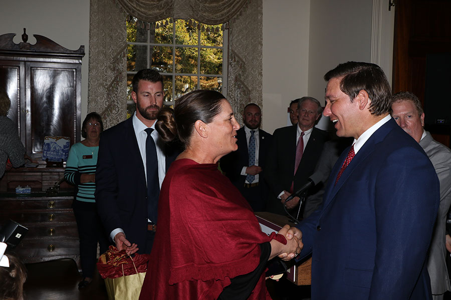 FSU head softball coach Lonni Alameda and Gov. Ron DeSantis at the Florida Governor's Mansion Wednesday, March 13, 2019. (Photo: Ryals Lee)