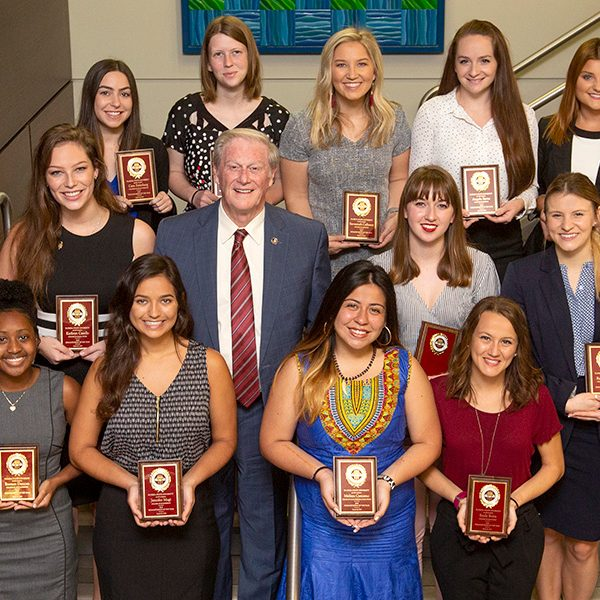 President Thrasher with the 2019 Humanitarian of the Year nominees. (From left to right) First row: Essence Duncan, Jennifer Magi, Melissa Carcamo, Emily Botta. Second row: Kathryn Casello, President John Thrasher, Sarah Grice, Rachel Castelli. Third row: Cara Steinberg, Madelene Wishart, Savannah Calleson, Angela Byrne, Monica McShaffrey. (FSU Photography Services)