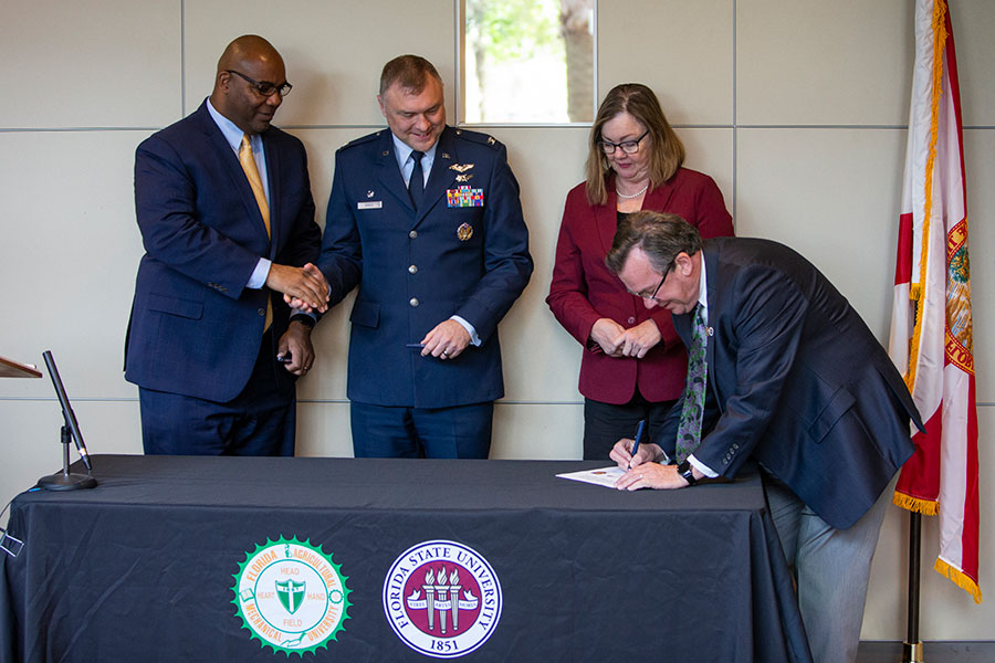 Florida A&M Provost Maurice Edington, Col. Garry Haase, FSU Provost Sally McRorie and FAMU-FSU College of Engineering Dean Murray Gibson participated in a ceremonial signing of the partnership March 18, 2019.