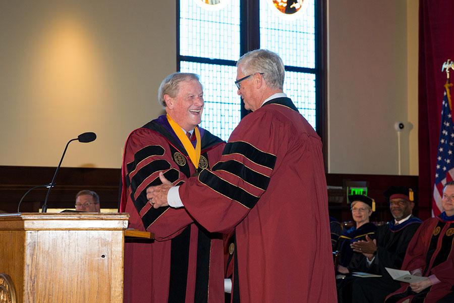 President John Thrasher congratulates his longtime friend and colleague, Allan Bense. (FSU Photo/Bill Lax)