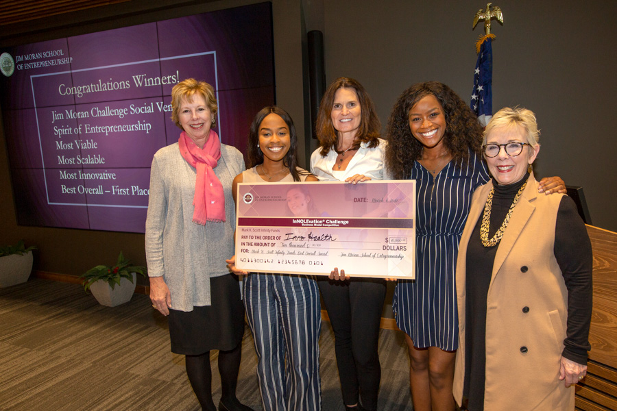 InnoHealth Diagnostics won the Mark K. Scott Infinity Funds $10,000 First Place prize at the InNOLEvation® Challenge. From left to right: Wendy Plant, Angela Udongwo of InnoHealth, Elizabeth Scott (judge), Nkechi Emetuche of InnoHealth and Susan Fiorito. (FSU Photography Services)