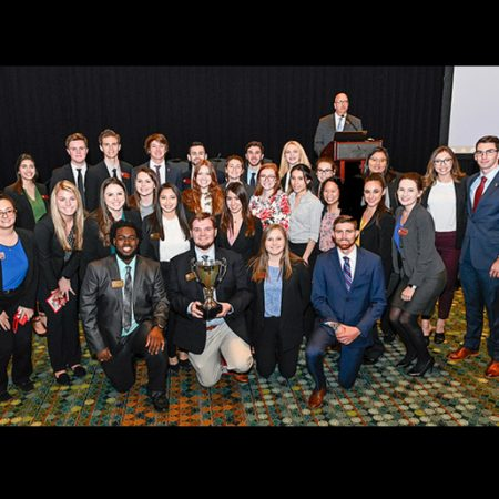 Dedman students receive the 2019 Student Chapter of the Year Award at the 2019 CMAA World Conference & Club Business Expo in Nashville.