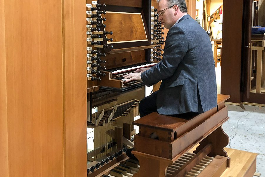 Assistant Professor of Organ and Coordinator of Sacred Music Iain Quinn plays an organ at Paul Fritts & Company Organ Builders in Tacoma, Washington. (Photo: Jayme Agee)