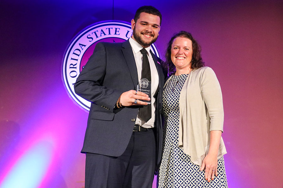 Kristian Diaz accepts a Student Seminole Award from Associate Vice President for Student Affairs Allison Crume at the Leadership Awards Night April 9, 2019. (Photo: Division of Student Affairs)