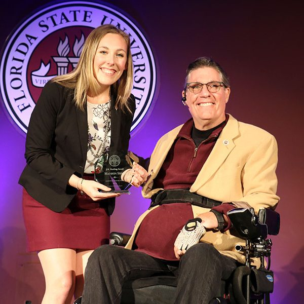 Madison Shaff accepts her first of three awards, the J.R. Harding Award, from J.R. Harding at the Leadership Awards Night April 9, 2019. (Photo: Division of Student Affairs)
